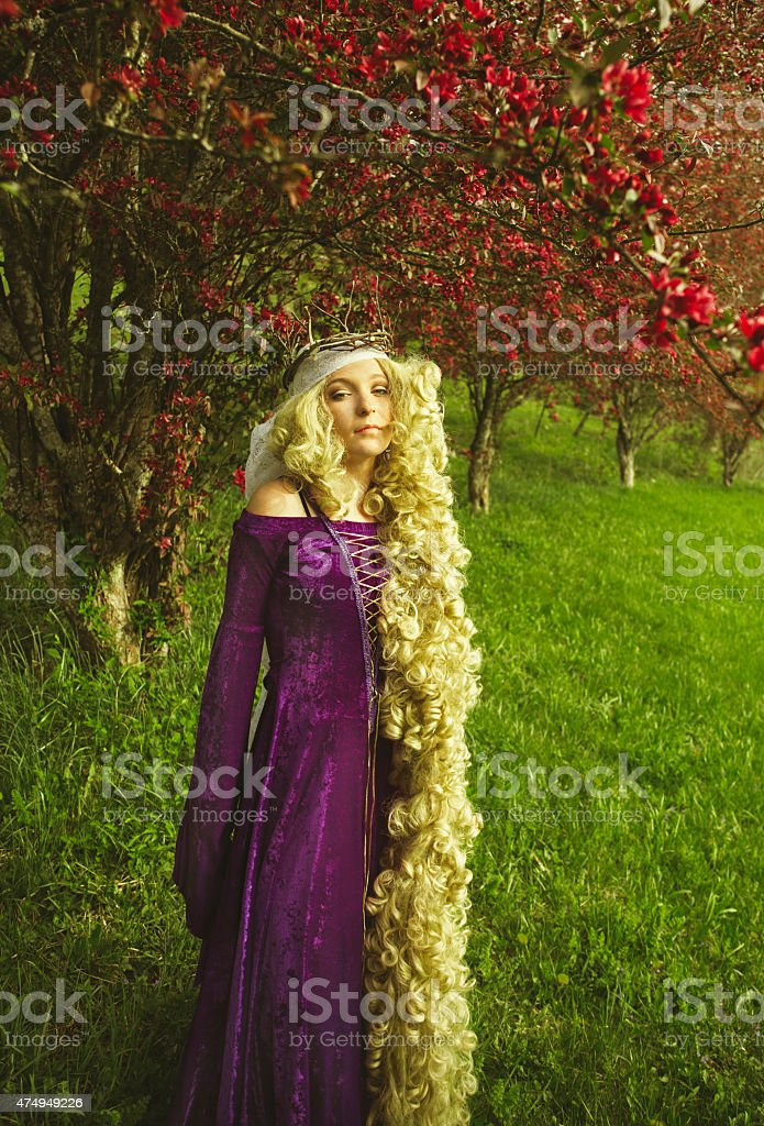 Woman dressed as Rapunzel from the fairy tale stock photo