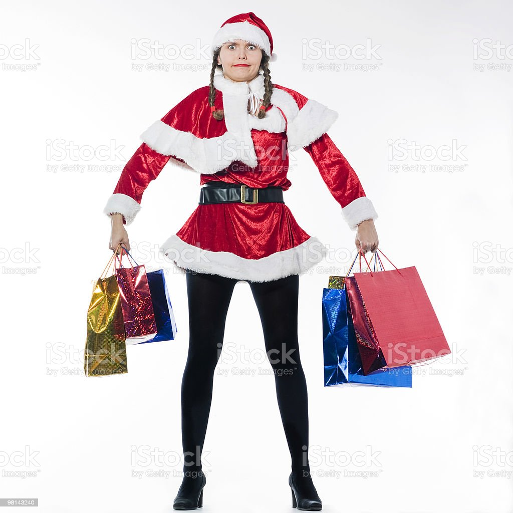 woman dressed as santa claus doing Christmas Shopping carrying bags royalty-free stock photo