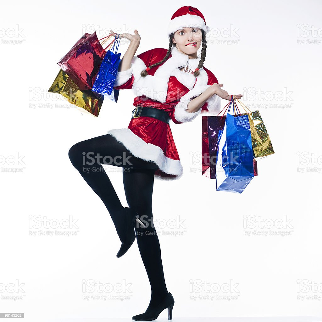woman dressed as santa claus doing Christmas Shopping royalty-free stock photo