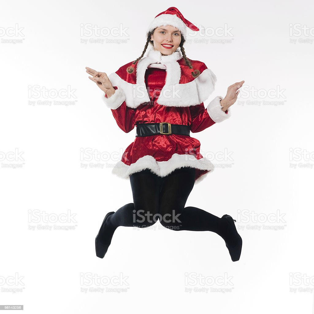 woman dressed as santa claus jumping royalty-free stock photo