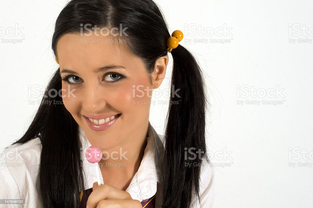 Woman dressed as School Girl with Lollypop royalty-free stock photo