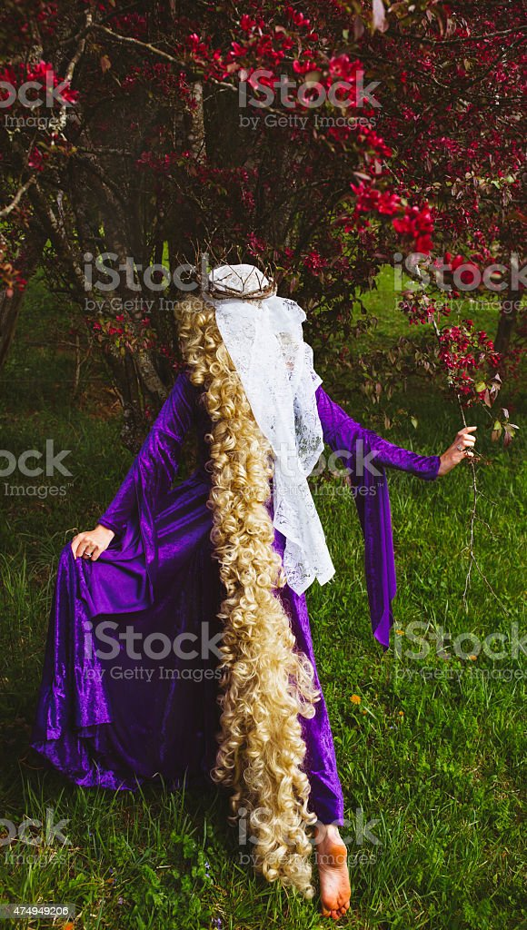 Woman dressed as the fairy tale character, Rapunzel stock photo
