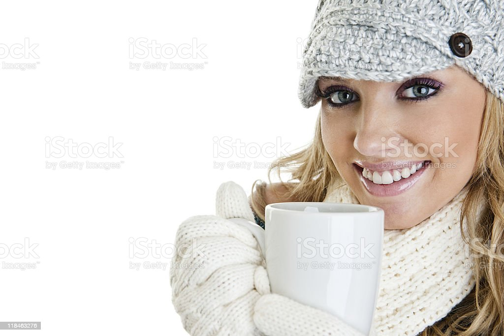 Woman dressed for winter drinking a warm beverage royalty-free stock photo