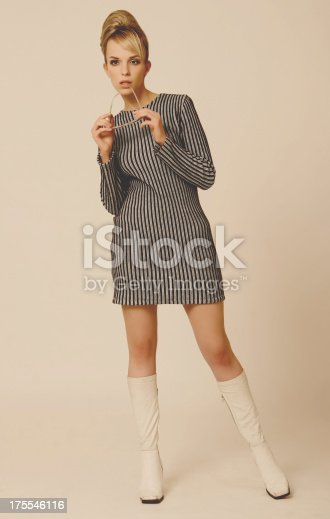 istock Woman dressed in a 1960s striped mini dress and go-go boots 175546116