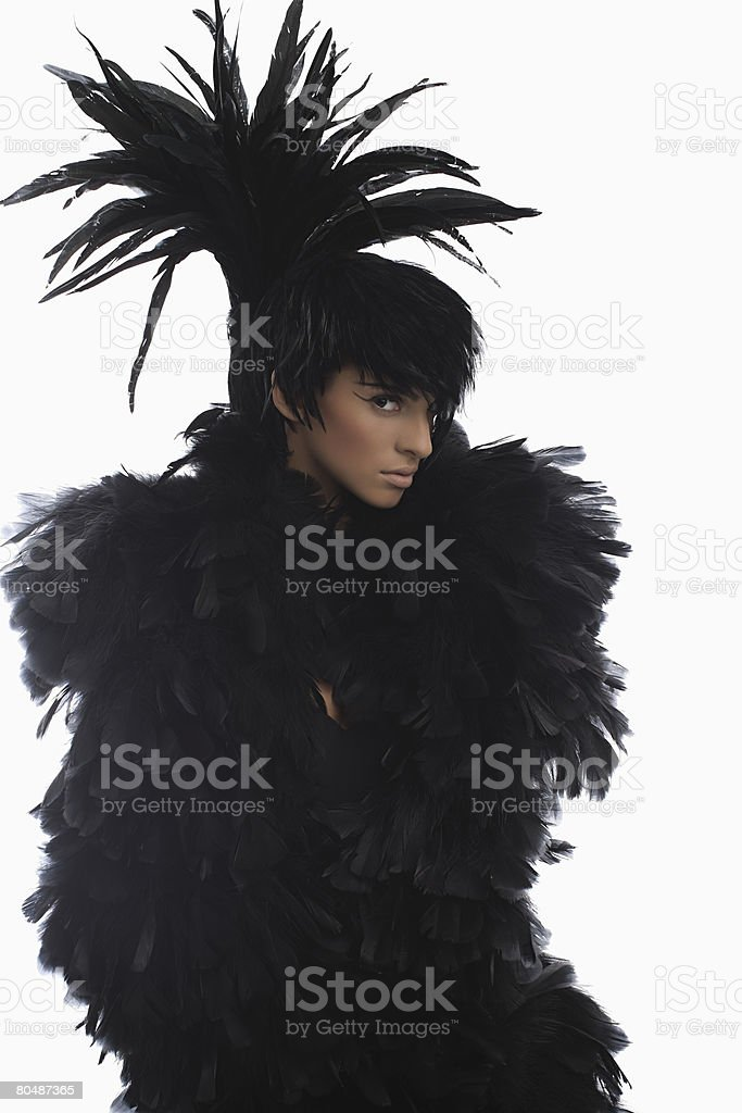 A woman dressed in a feather outfit royalty-free 스톡 사진
