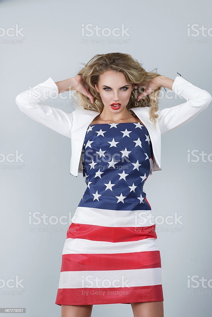 Woman dressed in american flag stock photo
