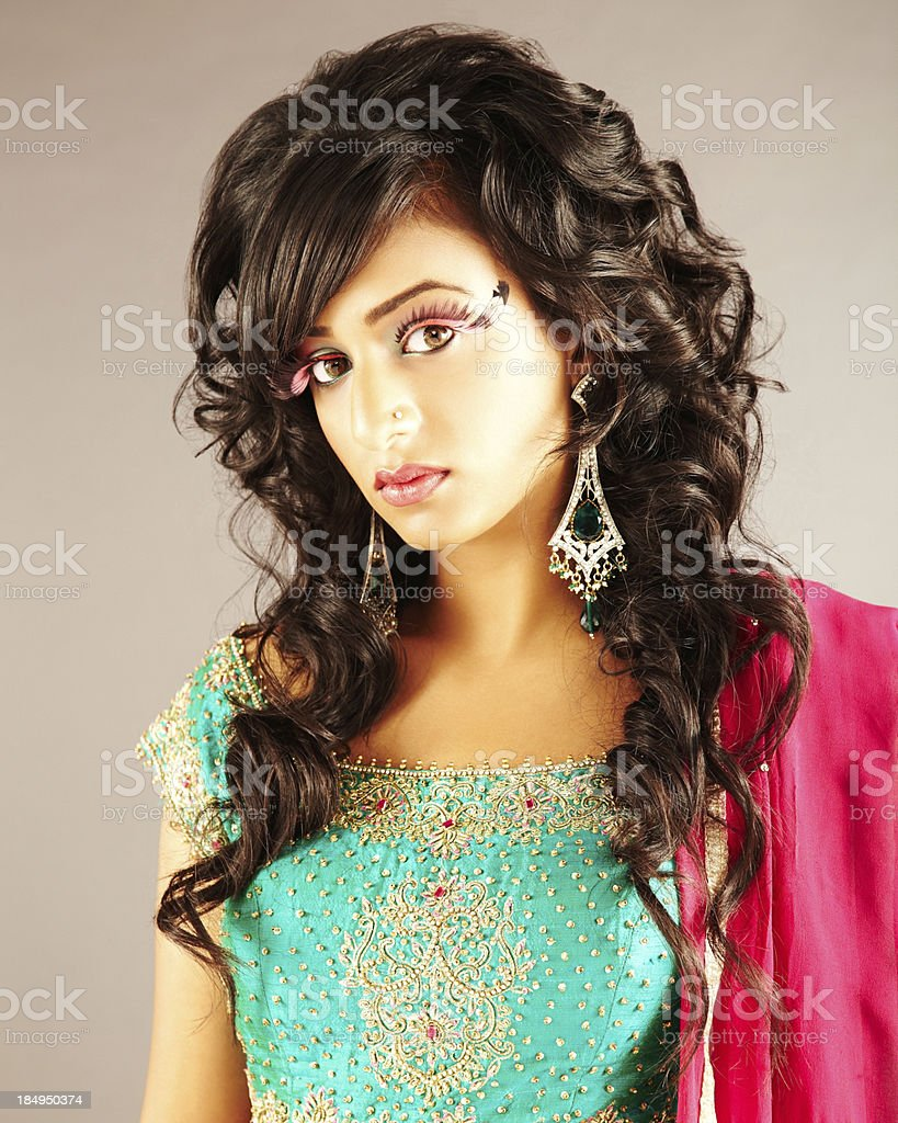 Woman dressed in indian clothing looking at camera royalty-free stock photo
