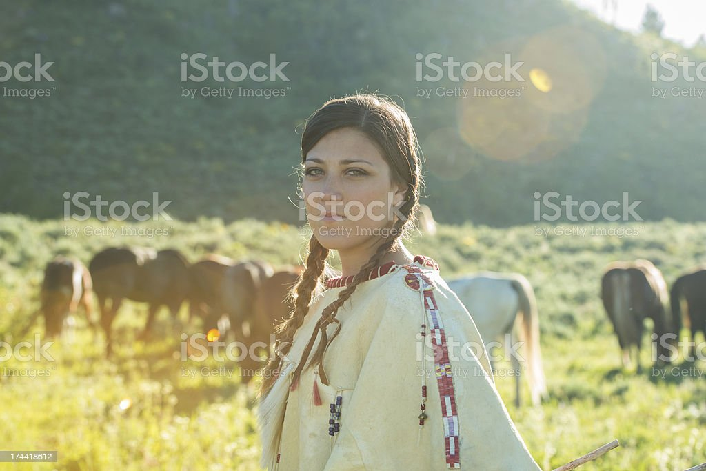 Woman Dressed in Traditional Native American Clothing stock photo
