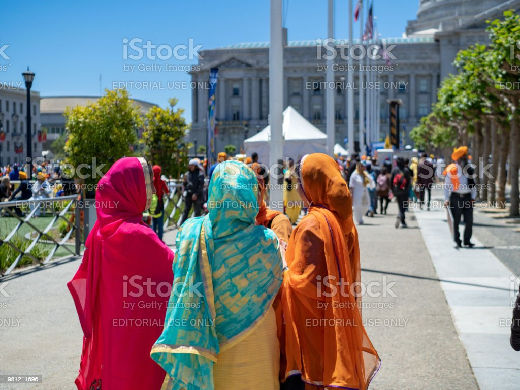 Woman dressed in traditional sikh garb talking outside of a Punjab referendum rally stock photo