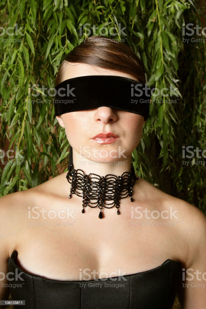 Woman Dressed Up and Wearing Blind Fold royalty-free stock photo