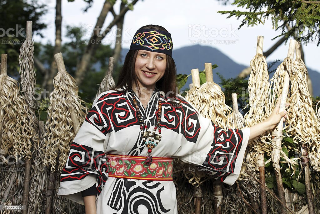 Woman dressed up in traditional costume of Ainu stock photo
