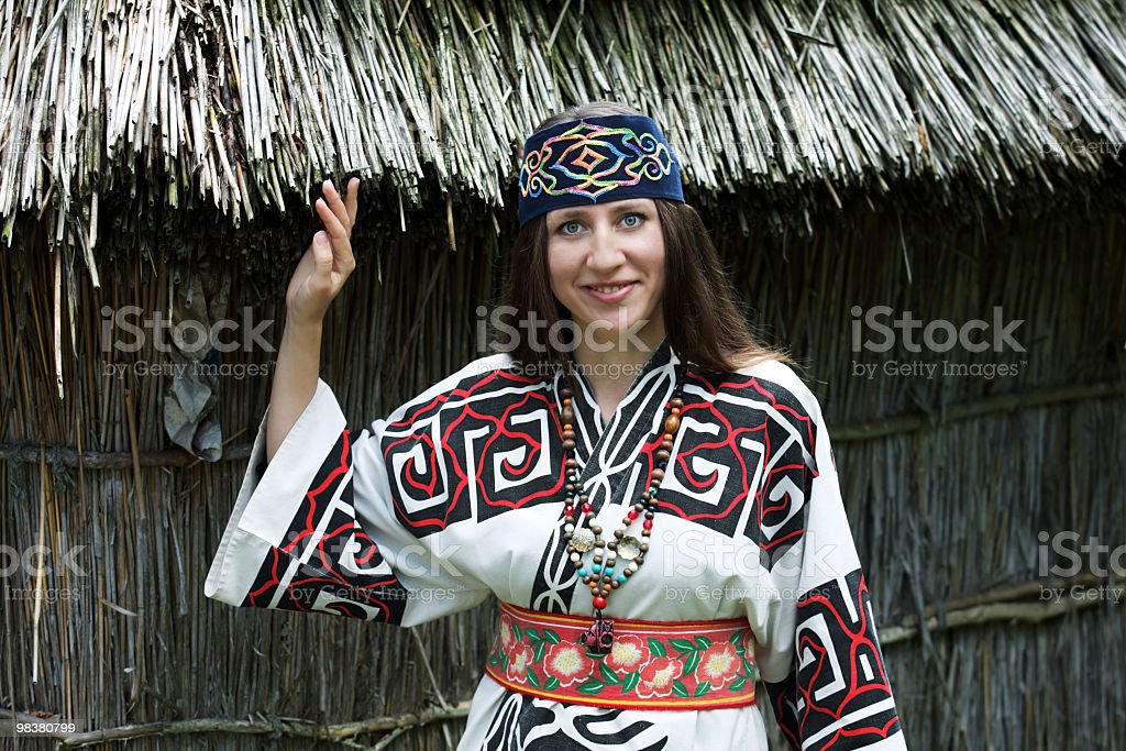 Woman dressed up in traditional costume of Ainu royalty-free stock photo