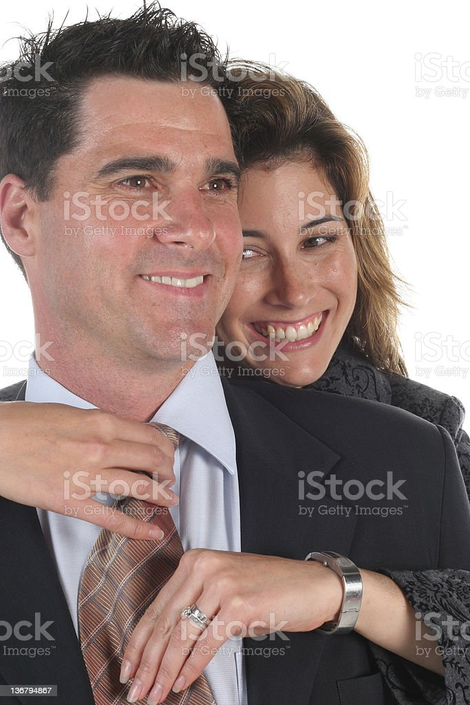 Woman dressing man royalty-free stock photo