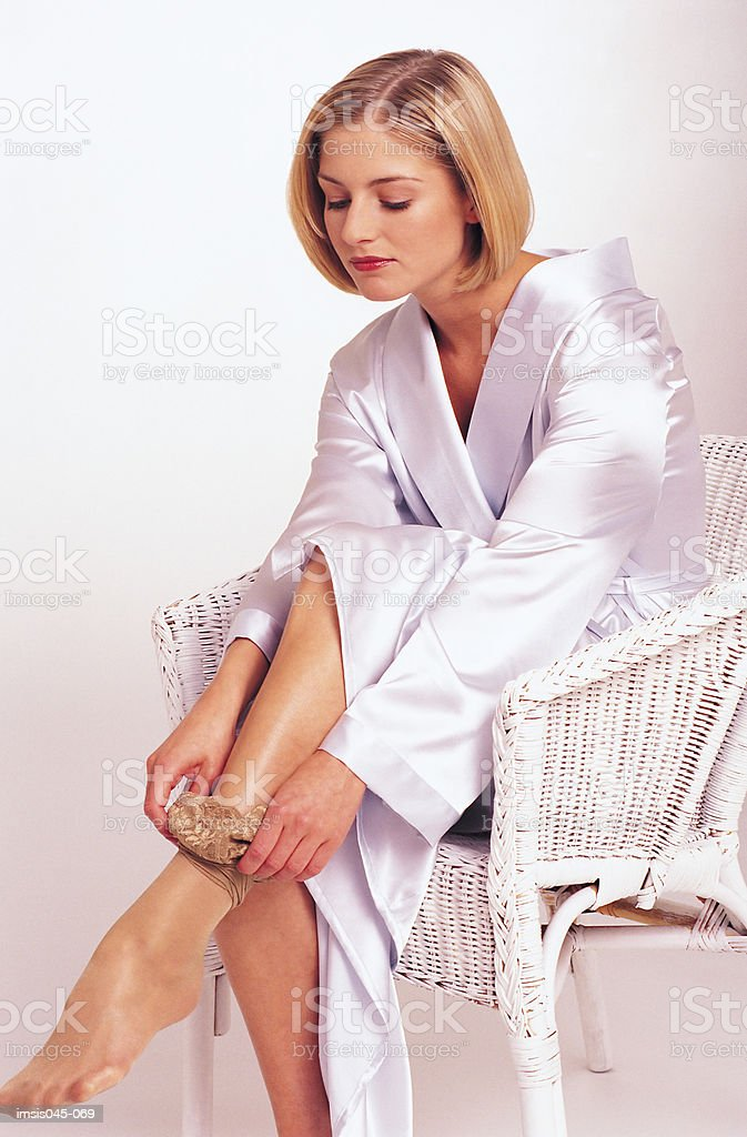 Woman dressing royalty-free stock photo
