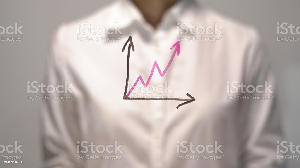 Woman drew Gradual Rise diagram with red up arrow on transparent screen. stock photo