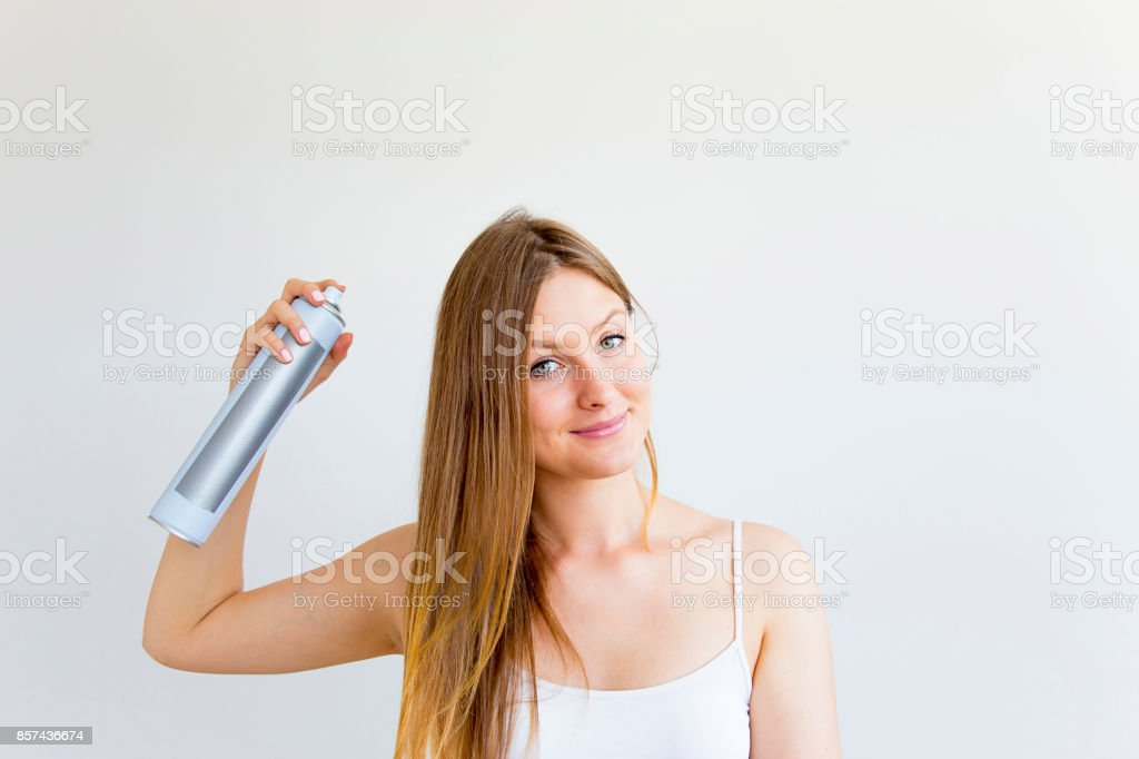Woman dries and styles her hair stock photo