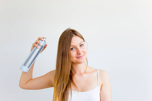 woman dries and styles her hair - dry stock pictures, royalty-free photos & images