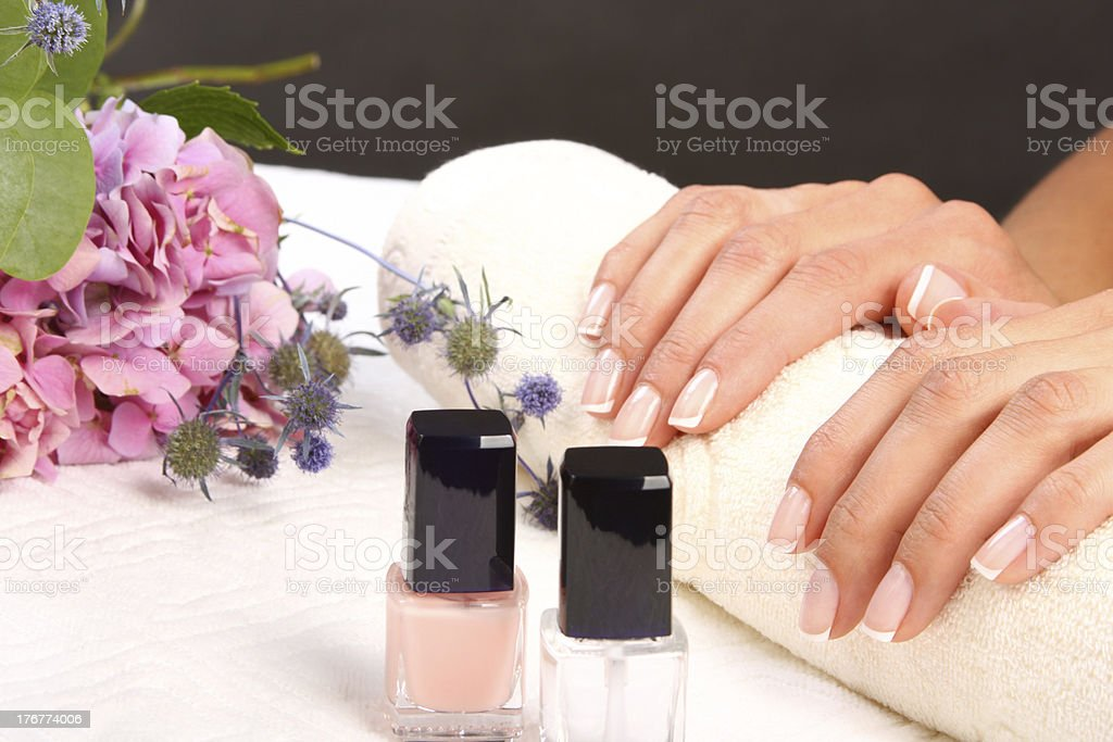Woman dries nails after polishing stock photo