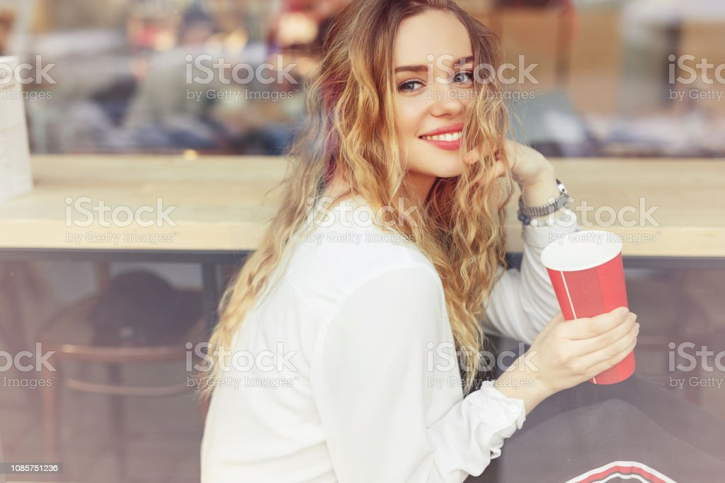 Woman Drink Her Hot Coffee While Sitting In Cafe Portrait Of
