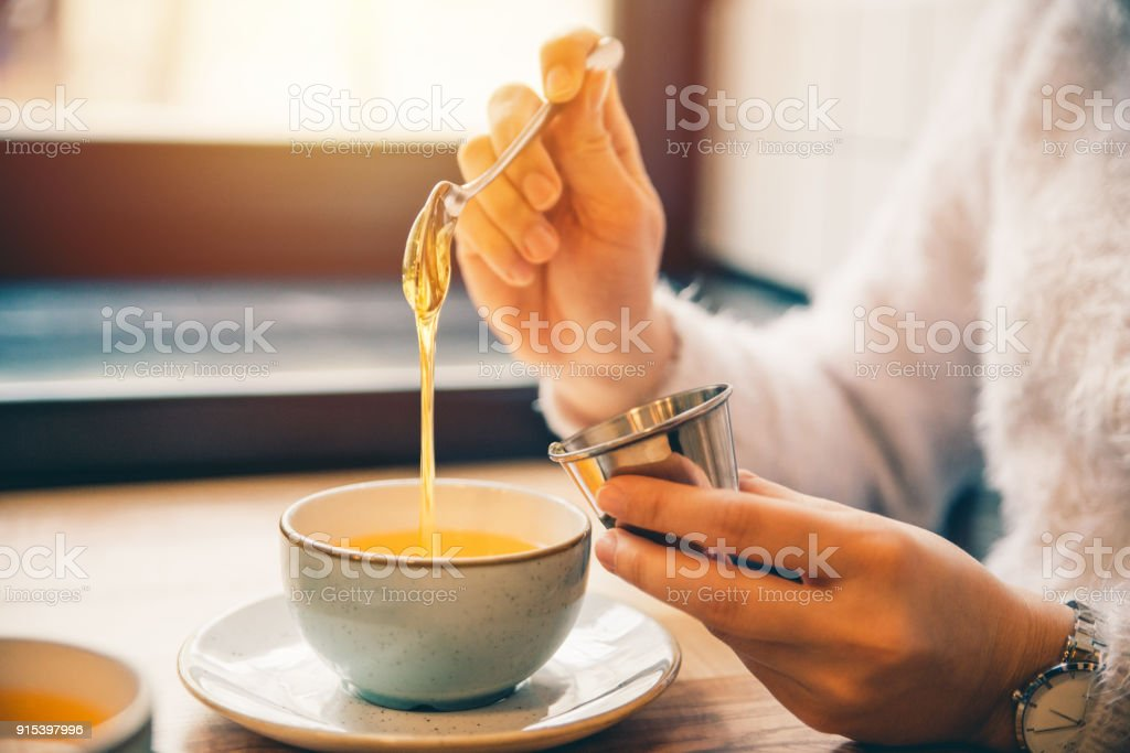 woman drink hot orange tea stock photo