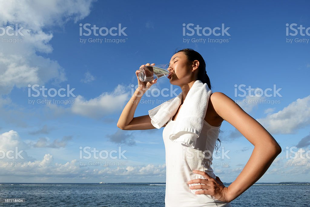 Woman Drink Water After Fitness stock photo