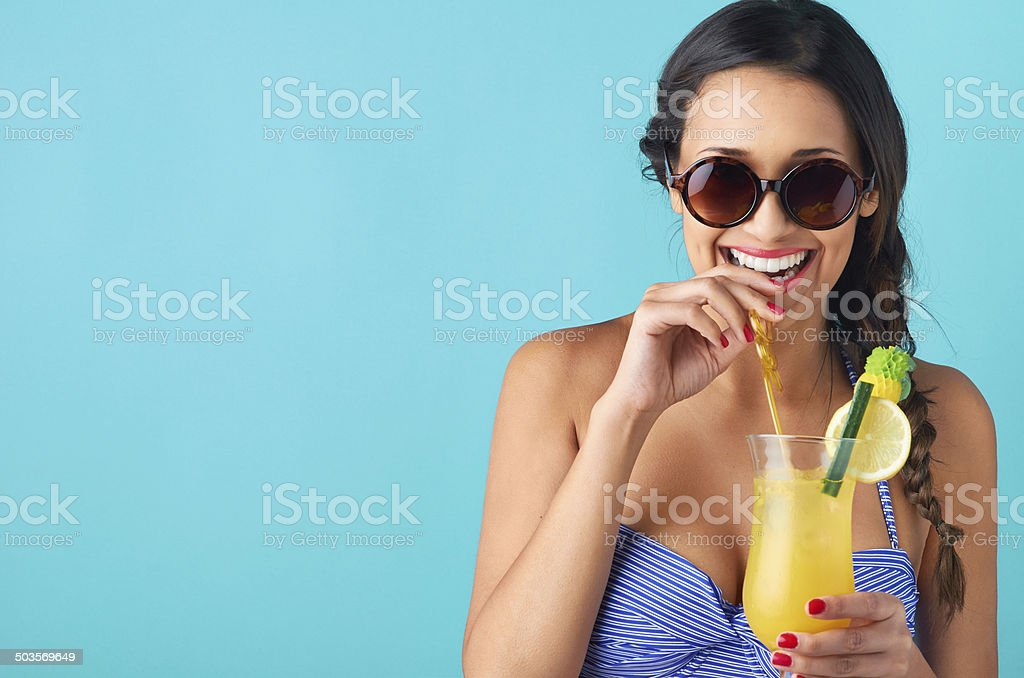 Woman drinking a cocktail stock photo
