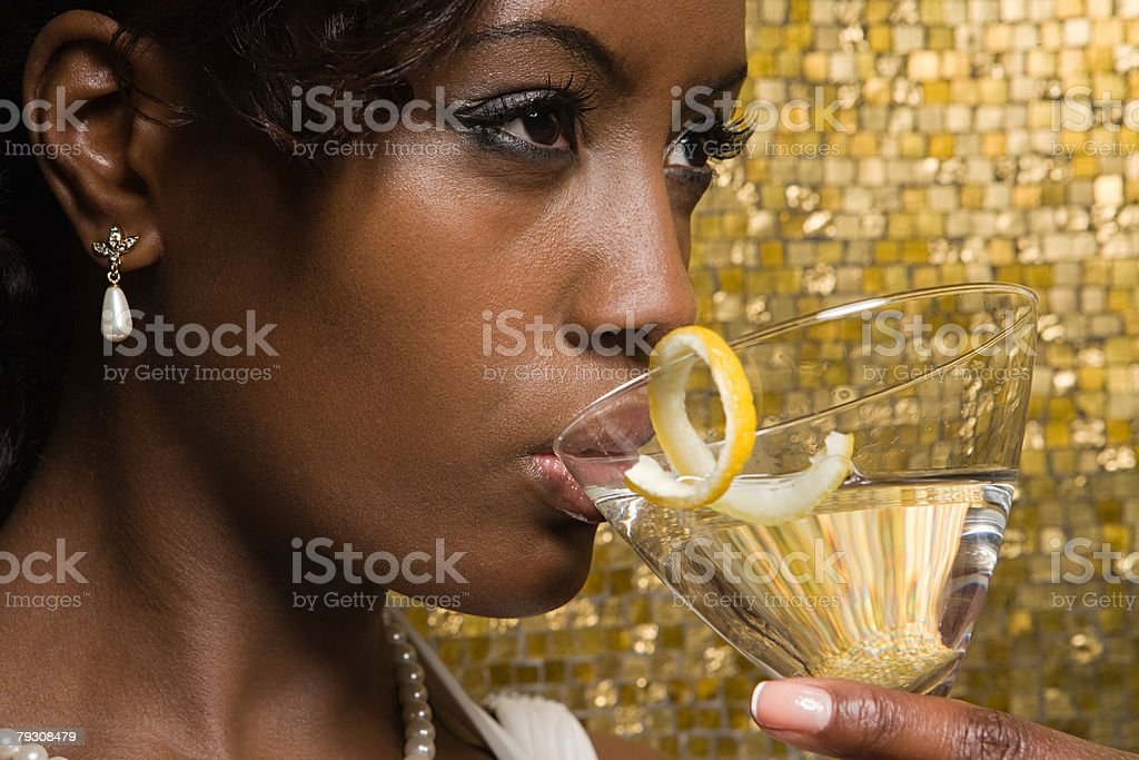 A woman drinking a cocktail royalty-free 스톡 사진