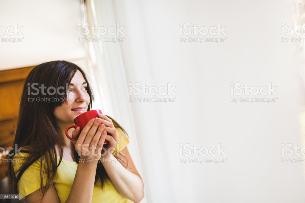 woman drinking a coffee at home royalty-free stock photo