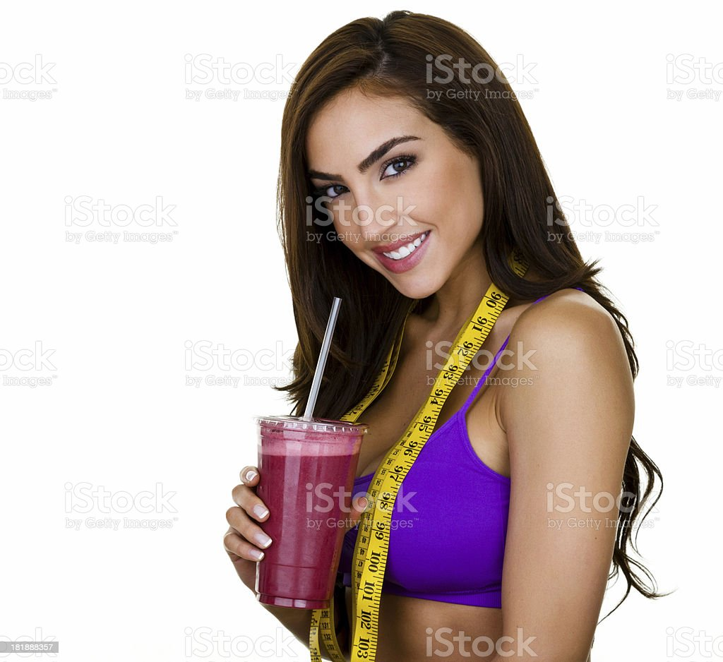 Woman drinking a fruit smoothie royalty-free stock photo