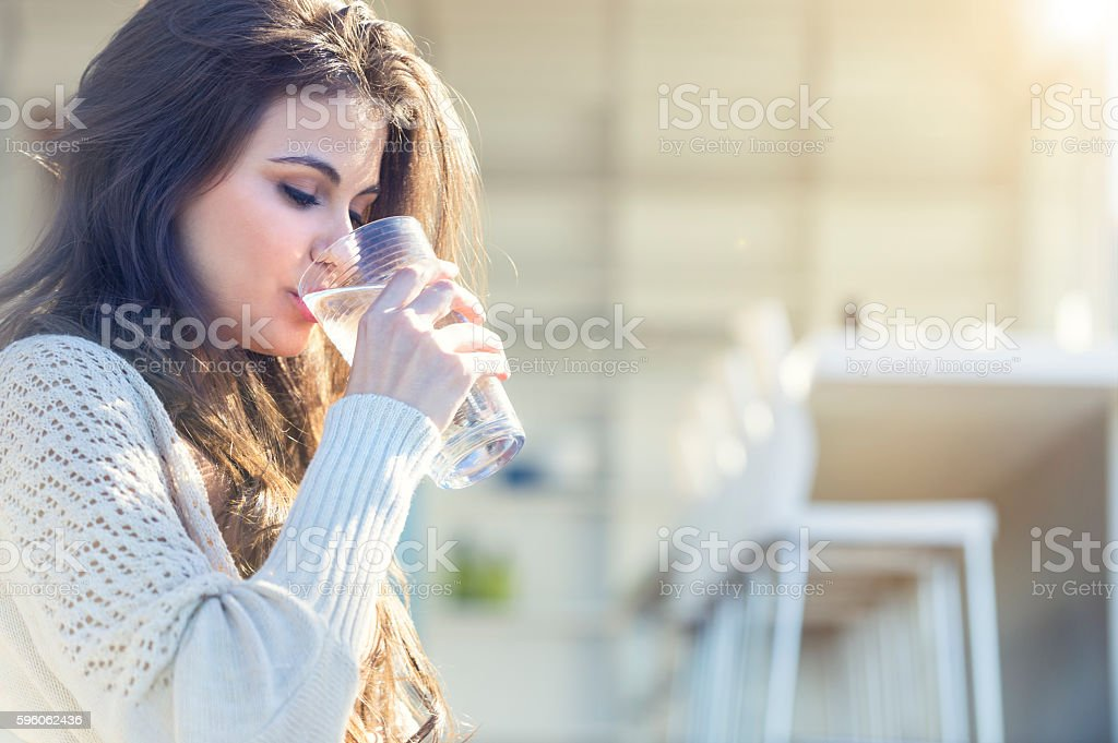Woman drinking a glass of water. royalty-free stock photo