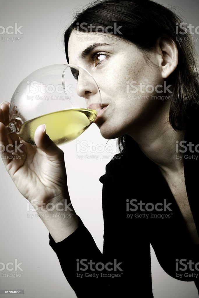 woman drinking a glass of wine stock photo