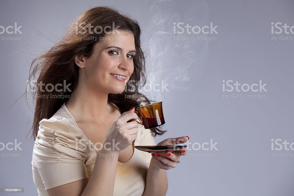 Woman drinking a hot drink royalty-free stock photo