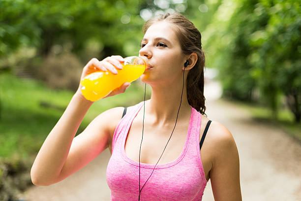 Woman drinking after sport stock photo