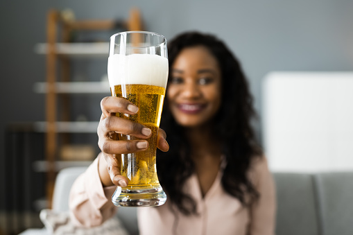 Woman Drinking Beverage Beer In Video Conference