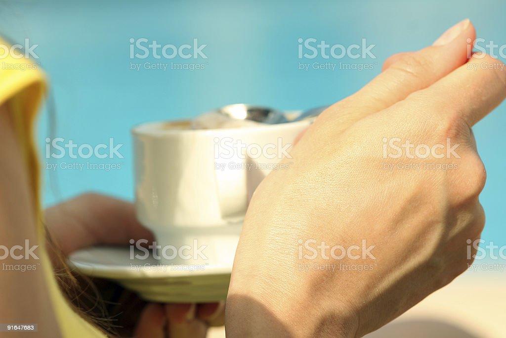 Woman drinking cappuchino royalty-free stock photo