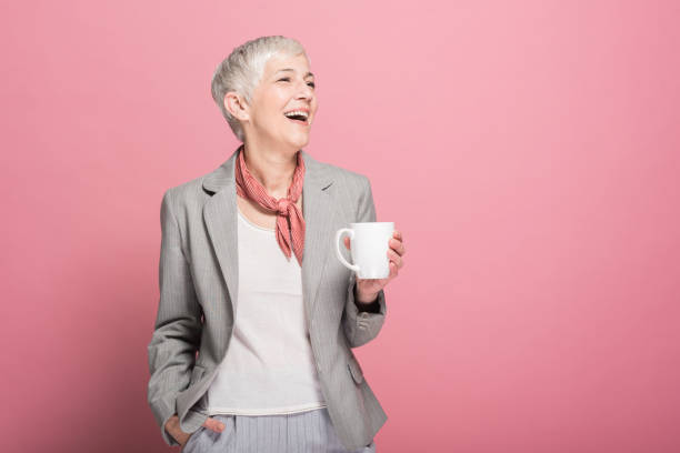 Woman drinking coffee and smiling stock photo