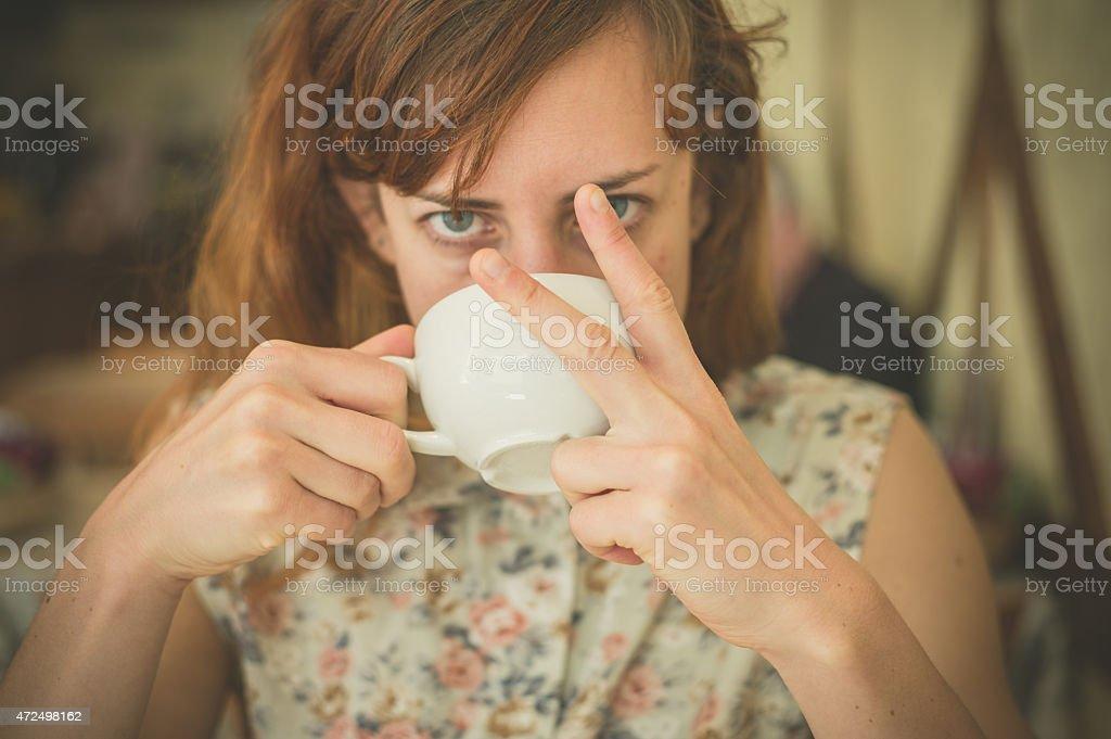 Woman drinking coffee and swearing stock photo
