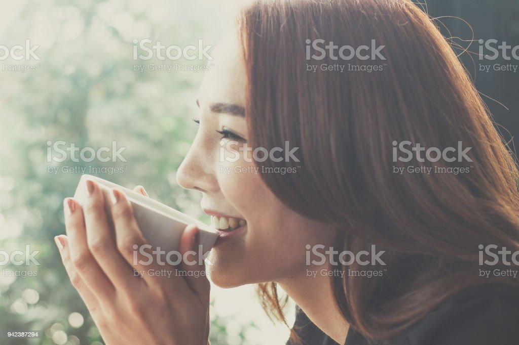 Woman drinking coffee at a coffee shop,Secretaries are happy when they drink coffee. royalty-free stock photo