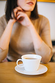 istock Woman drinking coffee at cafe 1200706499