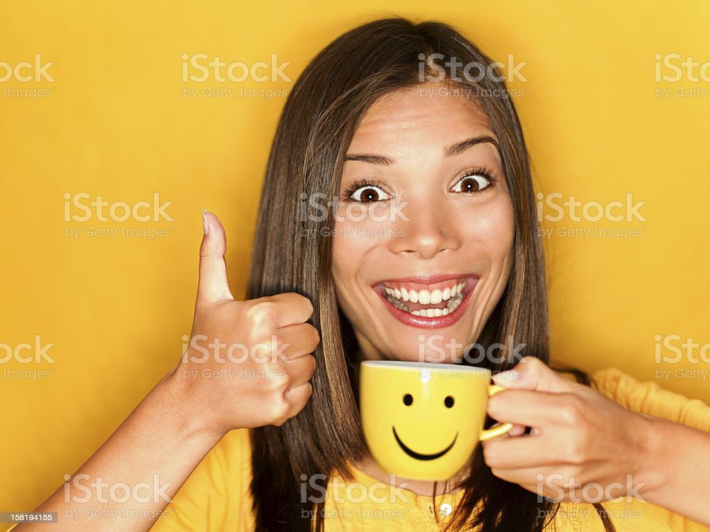 Woman drinking coffee happy thumbs up stock photo