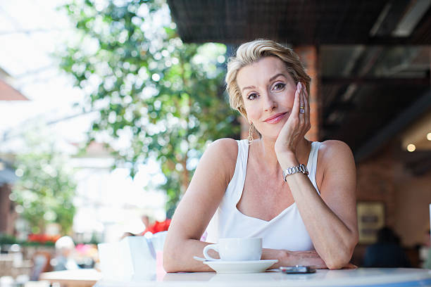 Woman drinking coffee in cafe  one mature woman only stock pictures, royalty-free photos & images