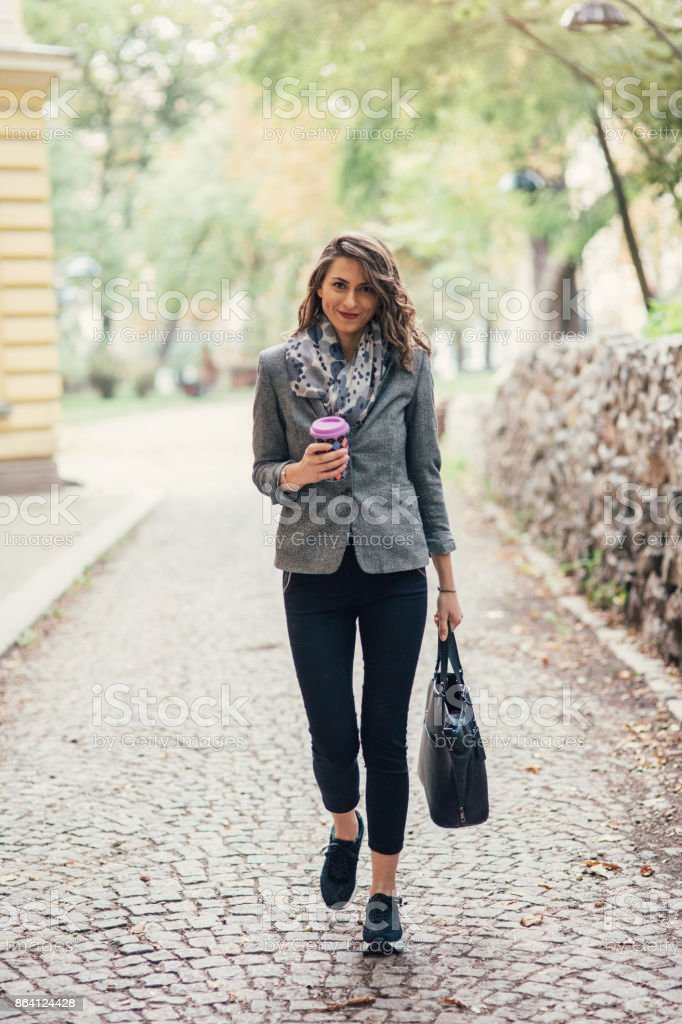 Woman drinking coffee in the city royalty-free stock photo