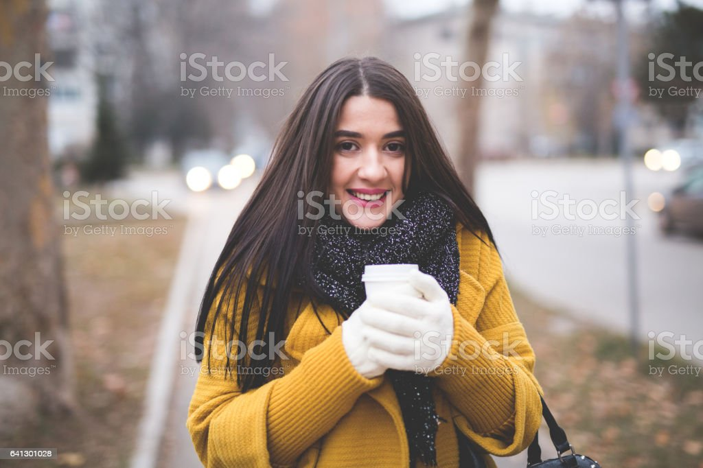 Woman drinking coffee in the local park stock photo