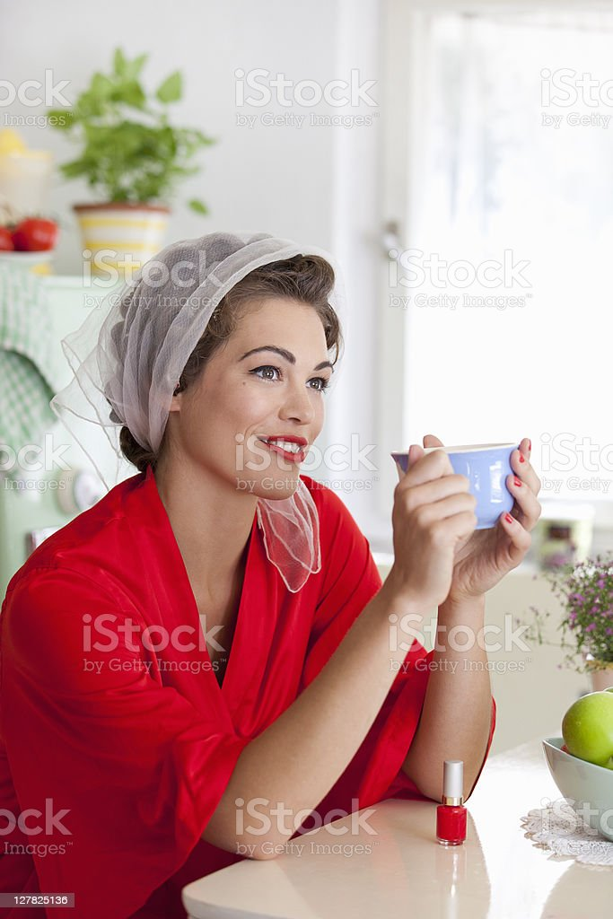 Woman drinking cup of coffee royalty-free stock photo