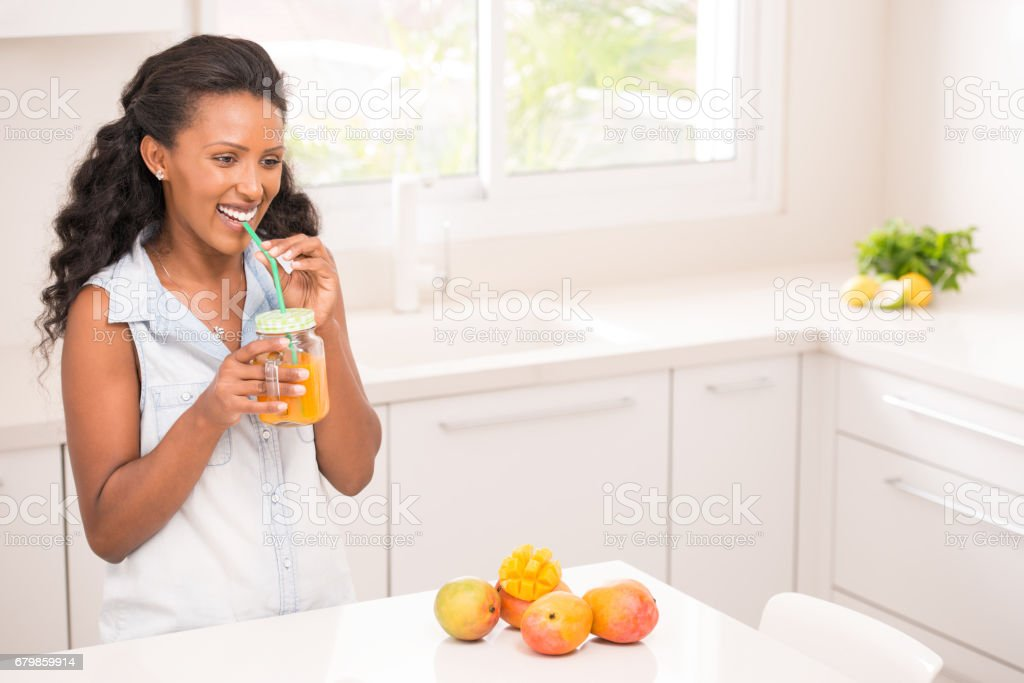 Woman Drinking Fresh Mango Juice Stock Photo Download Image Now