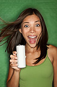 istock Woman drinking from blank can 142640288