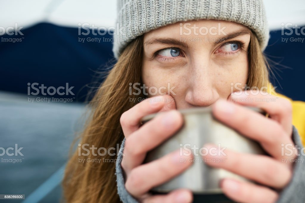 Woman drinking from thermos stock photo