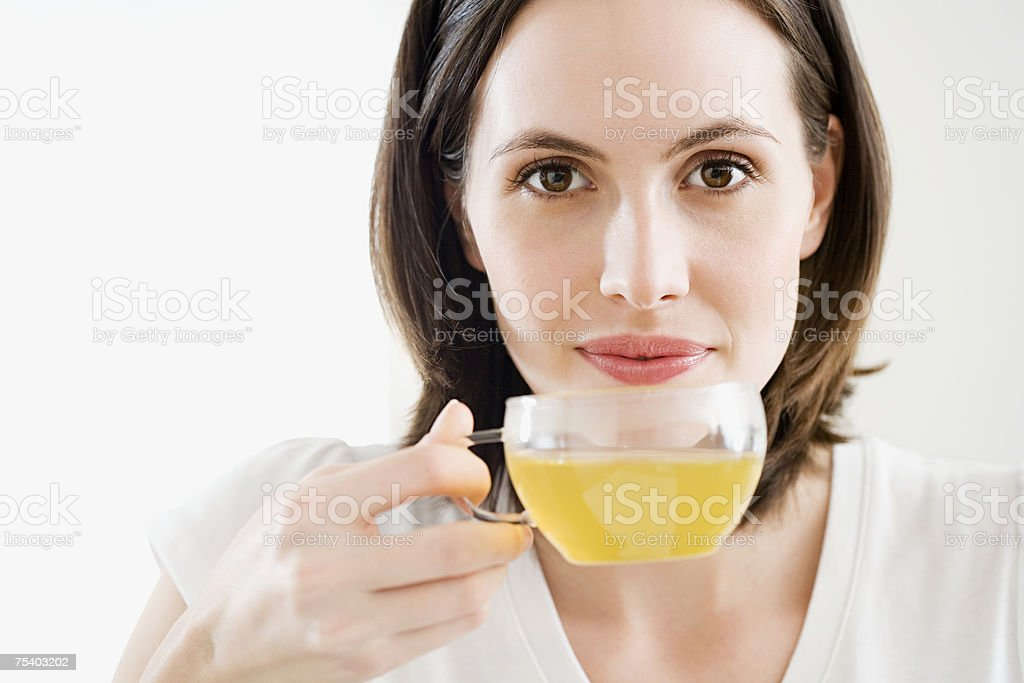 Woman drinking green tea stock photo