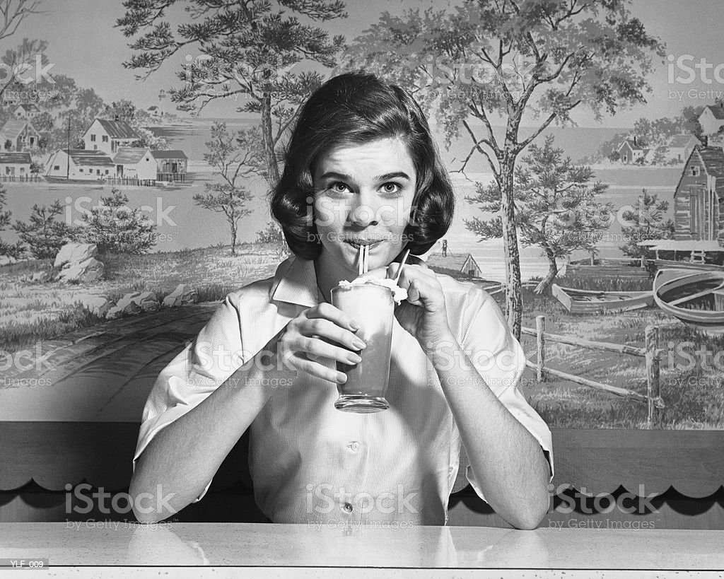 Woman drinking ice cream soda royalty-free stock photo