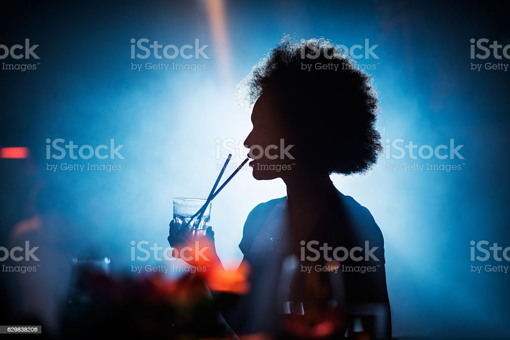 Woman drinking in the bar stock photo
